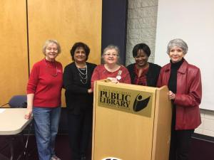 Fayetteville NOW President Sharon Johnson with Dr. Aziz and committed members. Photo Credit: Dr. Aziz