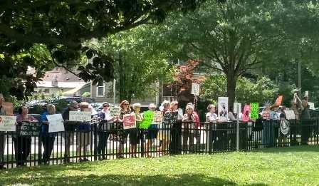Participants along fence outside of Senator Tillis' office in Raleigh